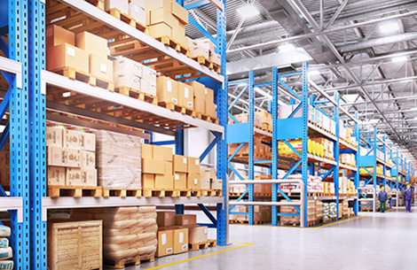 Kingstown Associates. Trading & Buying. boxes stacked on to of each other in a warehouse.